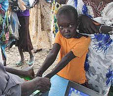 Kind bei der Lebensmittelverteilung in Bentiu